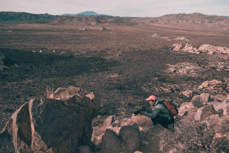 High angle view of man climbing on mountain