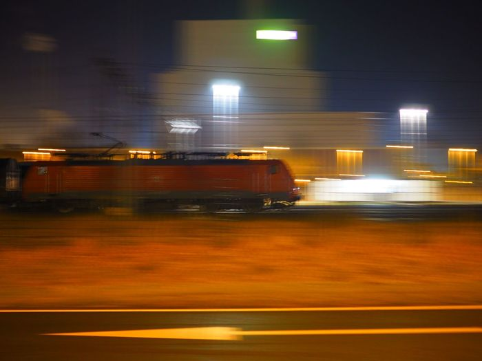 Power plant, freight locomotive and road in Amsterdam Westpoort Blurred Motion City Freight Freight Transportation Illuminated Industry Night No People Outdoors Power Rail Transportation