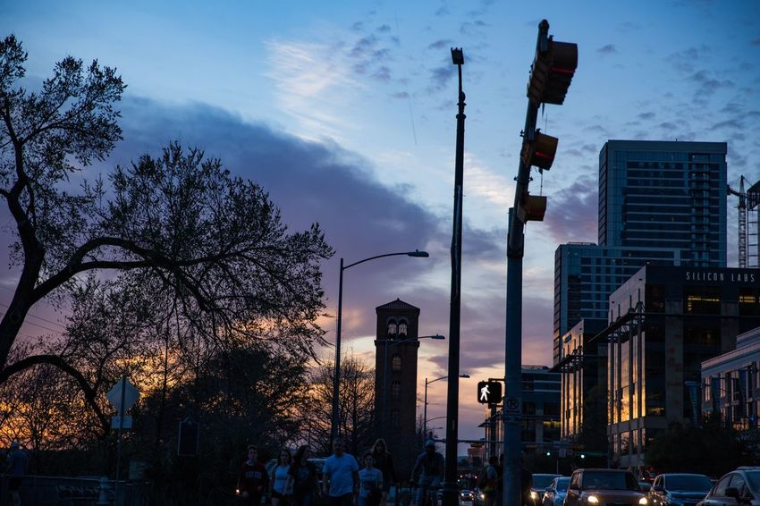 the sunset and the city. Downtown Dark Traffic Street Sky City Sunset Road Street Light Tree Transportation Building Illuminated Cloud - Sky Motor Vehicle Low Angle View