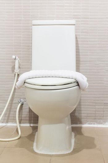 Towel On Toilet Seat In Bathroom