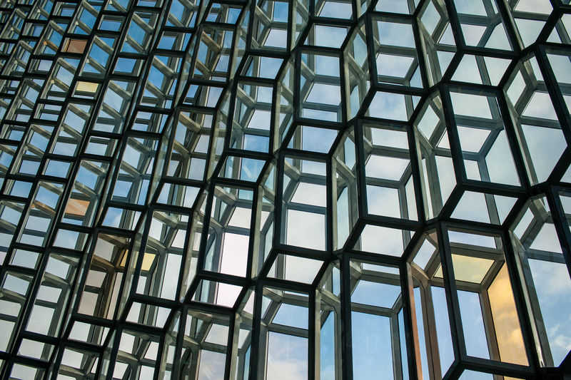 Harpa concert hall, Reykjavik Architecture Low Angle View Built Structure Glass - Material Full Frame Modern Building Exterior Geometric Shape Day Architectural Feature Sky Blue Office Building Repetition Tall - High No People Cloud - Sky Diminishing Perspective Harpa Harpareykjavik Harpa Concert Hall Music Hall Background First Eyeem Photo