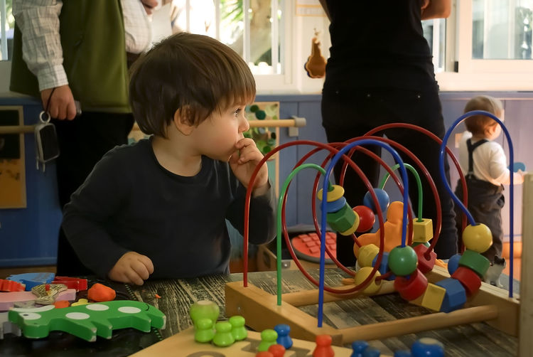 A kid learning by doing Childhood Boys Indoors  Multi Colored Innocence Playing Babyhood Baby Kinder Learning Skills  Exploring