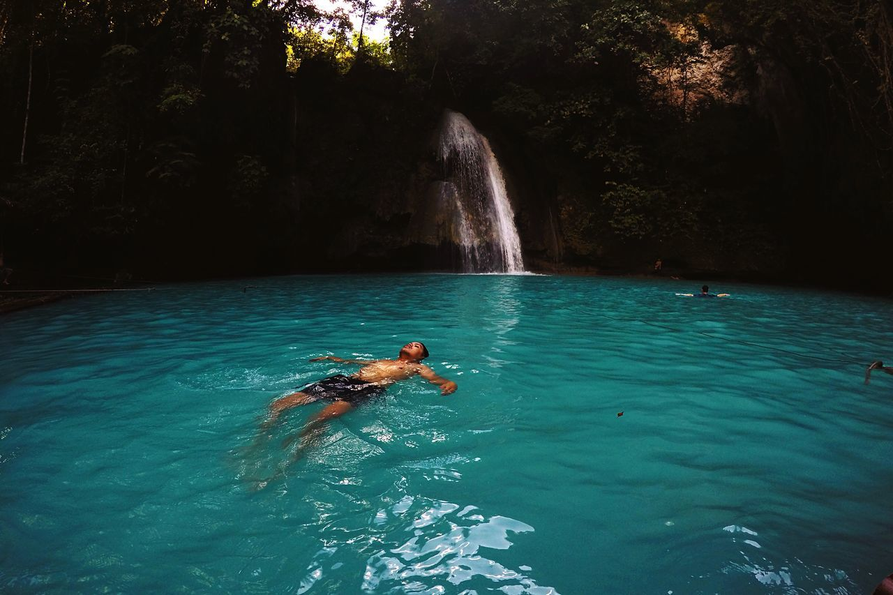 Man swimming at kawasan falls