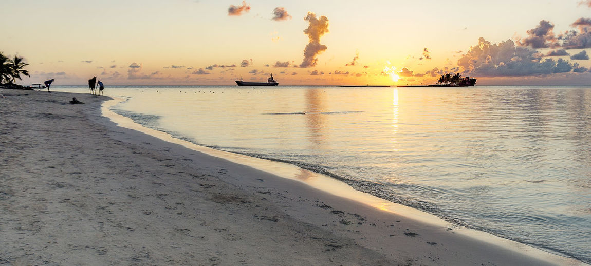 Beach Beauty In Nature Horizon Horizon Over Water Land Nature Orange Color Outdoors Real People Reflection Sand Scenics - Nature Sea Silhouette Sky Sunset Tranquil Scene Tranquility Water