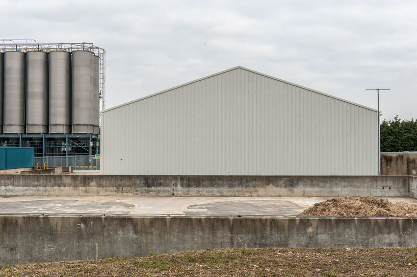 Industrial storage facility Industrial Architecture Building Exterior Built Structure Cloud - Sky Corrugated Iron Day Industry No People Outdoors Sky Storage Storage Tank Storage Tanks