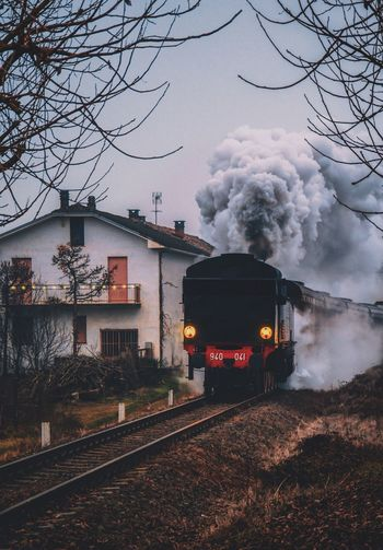 Rail Transportation Railroad Track Track Train Train - Vehicle Smoke - Physical Structure Sky Transportation Mode Of Transportation Tree Built Structure Nature Building Exterior Architecture Public Transportation No People Steam Train Plant Motion Emitting Outdoors Langhe Piedmont Italy EyeEmNewHere EyeEm Best Shots