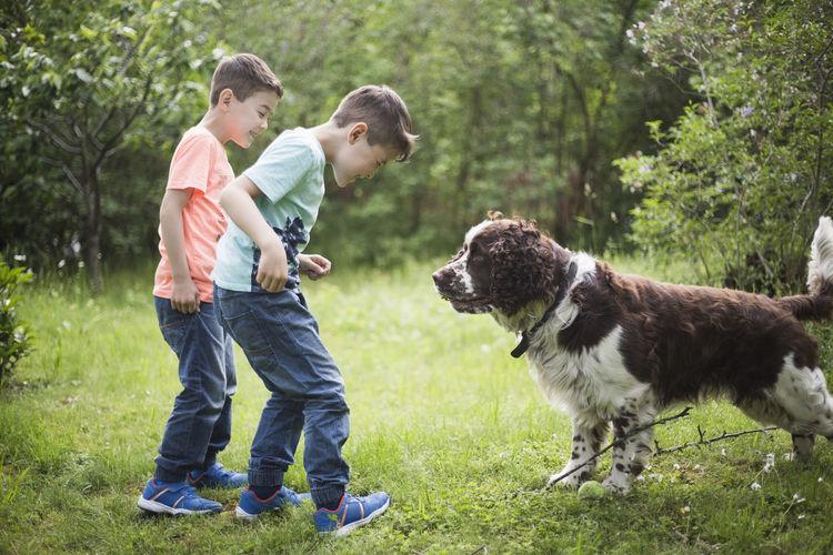 Full length of men and dog