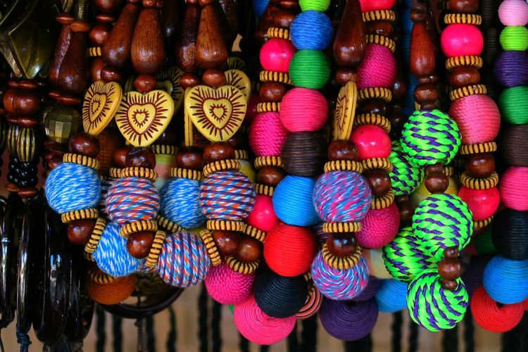Close-up of colorful decorations for sale at market