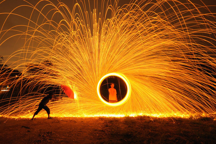 Spinning steel wool Blurred Motion Burning Circle Danger Expertise Flame Formation Glowing Heat - Temperature Illuminated Light Painting Long Exposure Men Motion Night One Person Performance Real People Shape Skill  Speed Spinning Spiral Swirl Wire Wool