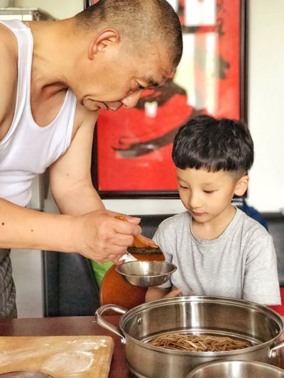 Love Handmade,Grandpa and boy. Can u guess what they are doing?ah,making BaoBao. Boys Family With One Child Indoors  Bowl Real People Togetherness Family Casual Clothing Food Son Childhood Men Day Young Adult Adult People Live For The Story