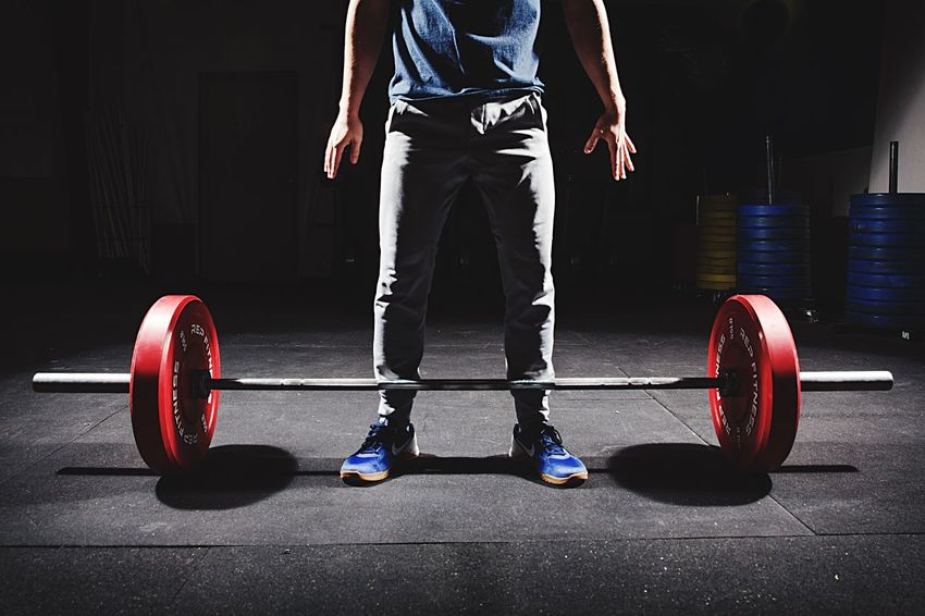 CrossFit Studio Gym Exercising Strength Sports Clothing Determination Lifestyles Sports Training Exercise Equipment Healthy Lifestyle Sport Athlete Effort Holding Cross Training Muscular Build Self Improvement Health Club Standing One Person Indoors