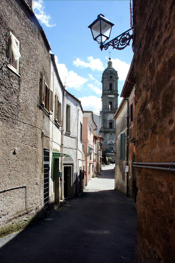 Glimpse with bell tower Italia Old Town Architecture Bell Tower Building Exterior Buildings Built Structure Campagnanodiroma Clouds And Sky Glimpse Lazio No People Outdoors Street The Way Forward Travel Destination Travel Destinaton