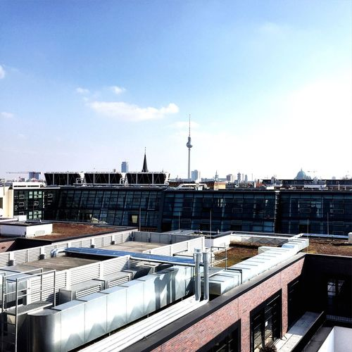 Distant view of fernsehturm against sky in city