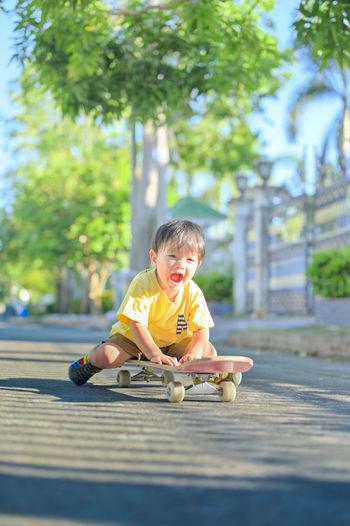 Portrait of boy wearing sunglasses against trees
