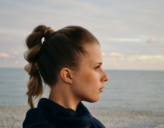Very nice girl 👧 Headshot Portrait One Person Sky Real People Sea International Women's Day 2019 Beach Water Nature Hairstyle Horizon Over Water Sunset Looking Beauty In Nature The Portraitist - 2019 EyeEm Awards