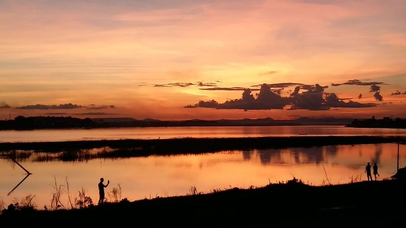 Dramatic Sky Sunset Water Scenics Tranquil Scene Lake Orange Color Tranquility Silhouette Reflection Beauty In Nature Majestic Sky Cloud - Sky Nature Lakeshore Atmospheric Mood Tourism Travel Destinations John Nelson No Filter, No Edit, Just Photography Vientiane Lifeasiseeit Silhouette Dramatic Sky