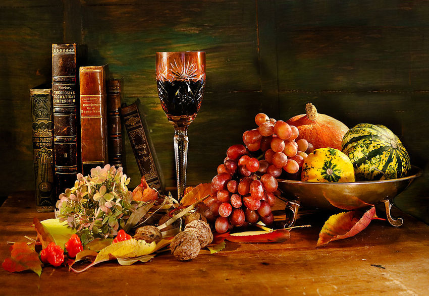 Food And Drink Table Flower Wood - Material Fruit Still Life Glass Pumkins Grapes Silver Bowl Red Wine Nuts Fruits Books Old Books Classic Still Life Wooden Table
