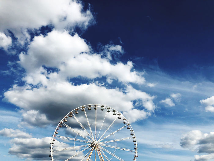 Low angle view of ferris wheel against sky