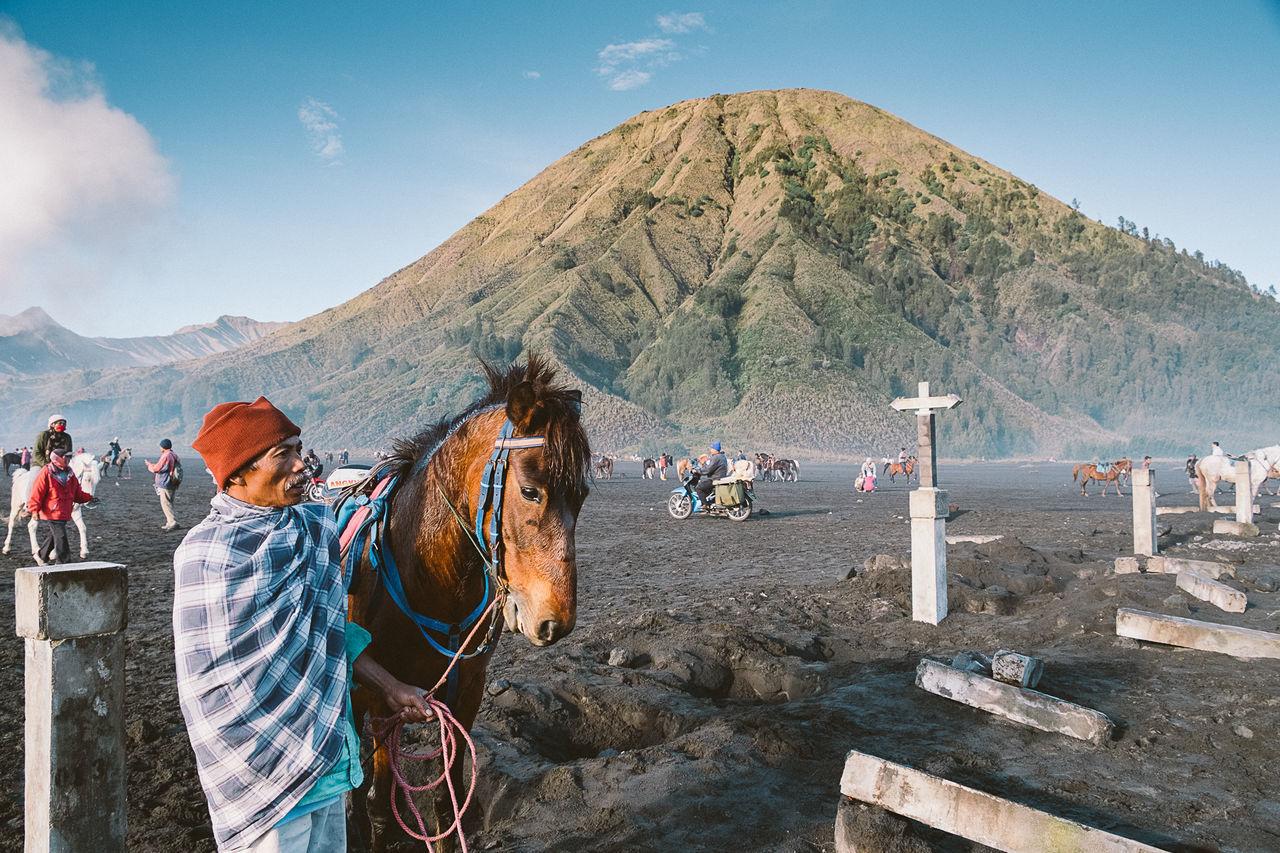 TOURISTS ON MOUNTAIN PEAK