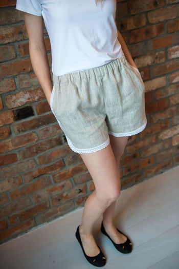 Fashion Adult Architecture Brick Wall Casual Clothing Day Girl Hot Pants Human Leg Indoors  Leisure Activity Lifestyles Linen Cloth Low Section One Person People Real People Shorts Skirt Standing Style Summer Fashion Women Young Adult Young Women Fashion Stories