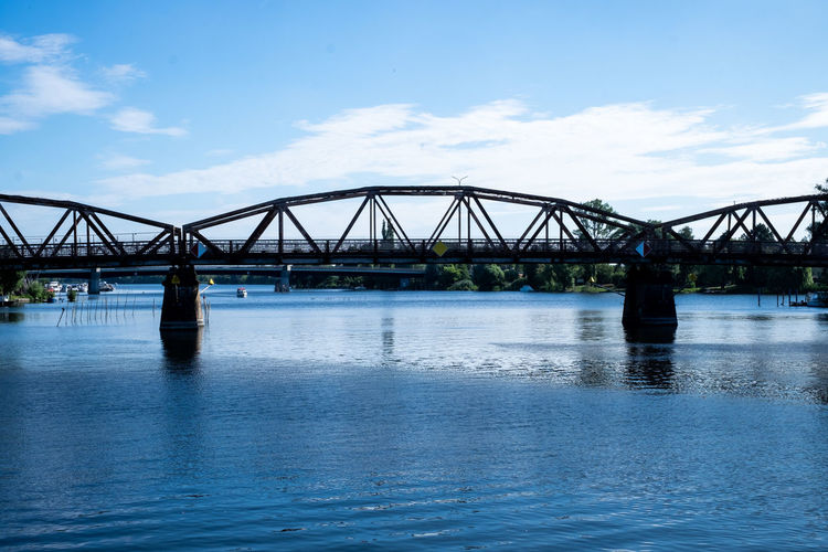 Clear Sky Tranquility Transportation Travel Photography Architecture Blue Blue Water Bridge Bridge - Man Made Structure Built Structure Cloud - Sky Connection Day Nature No People Outdoors River Sky Transportation Travel Travel Destinations Water Waterfront