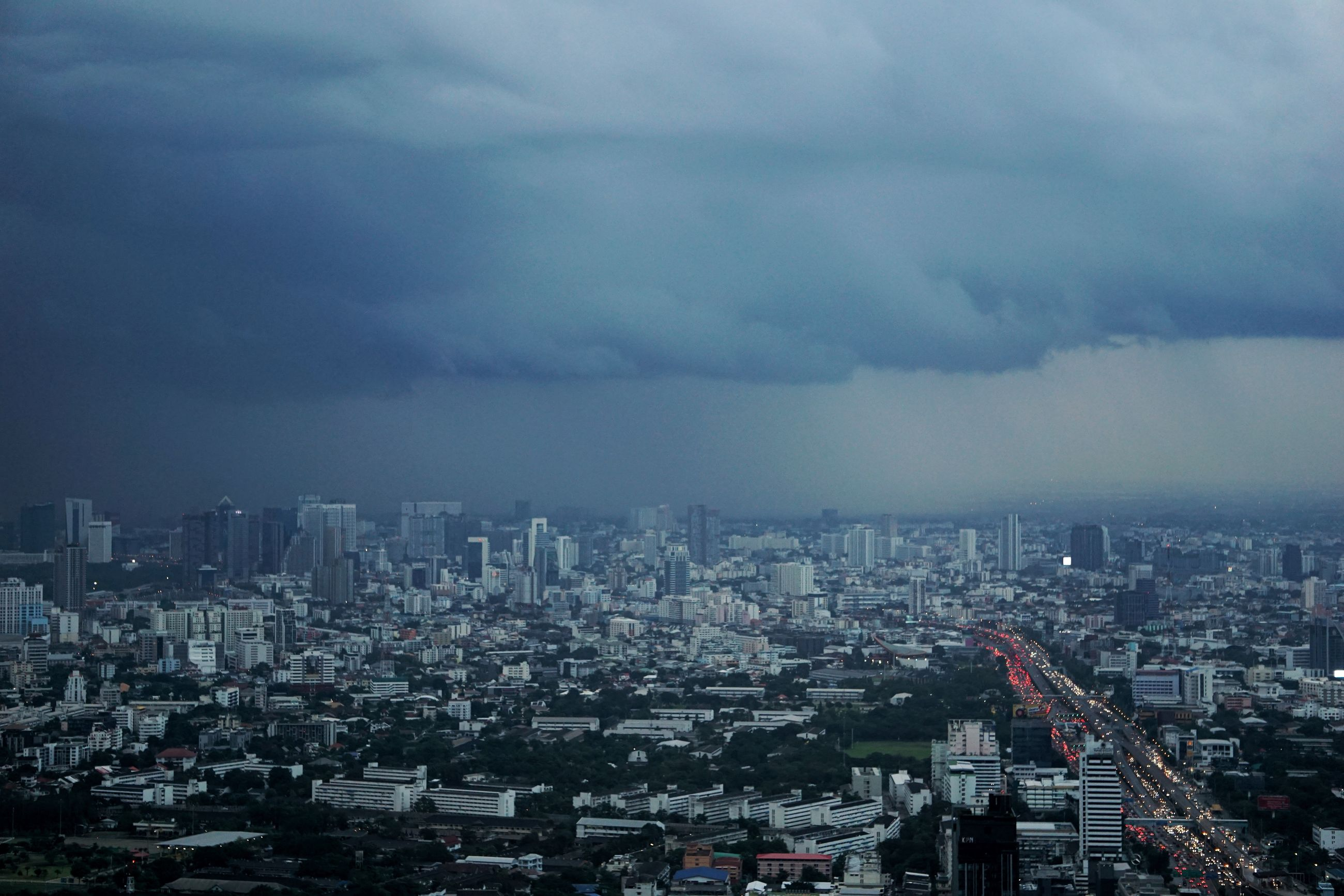 cloud - sky, cityscape, building exterior, city, sky, architecture, built structure, crowd, building, nature, crowded, residential district, overcast, outdoors, landscape, high angle view, skyscraper, community, office building exterior, ominous, settlement