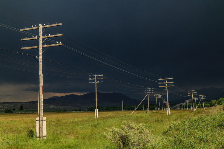Before a storm Dark Clouds Dark Sky Kyrgyzstan Travel Travel Photography Cable Electricity  Electricity Pylon Field Grass Land Landscape No People Power Line  Power Supply Sky
