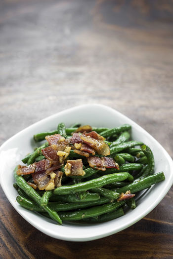 butter sauteed green beans with bacon tapas Beans Green Green Beans Snack Tapas Bacon Bowl Close-up Focus On Foreground Food Food And Drink Freshness Healthy Eating Indoors  Meal Meat No People Plate Ready-to-eat Sauteed Sauteed Veggies Serving Size Starter Table Vegetable First Eyeem Photo