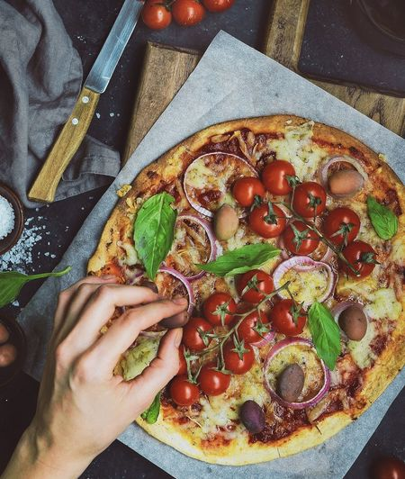 hand adding a olive to pizza Pizza Homemade Tomatoes Rustic Foodie­ Eating Human Hand High Angle View Close-up Food And Drink Various Comfort Food Crunchy White Bread Stuffing - Food