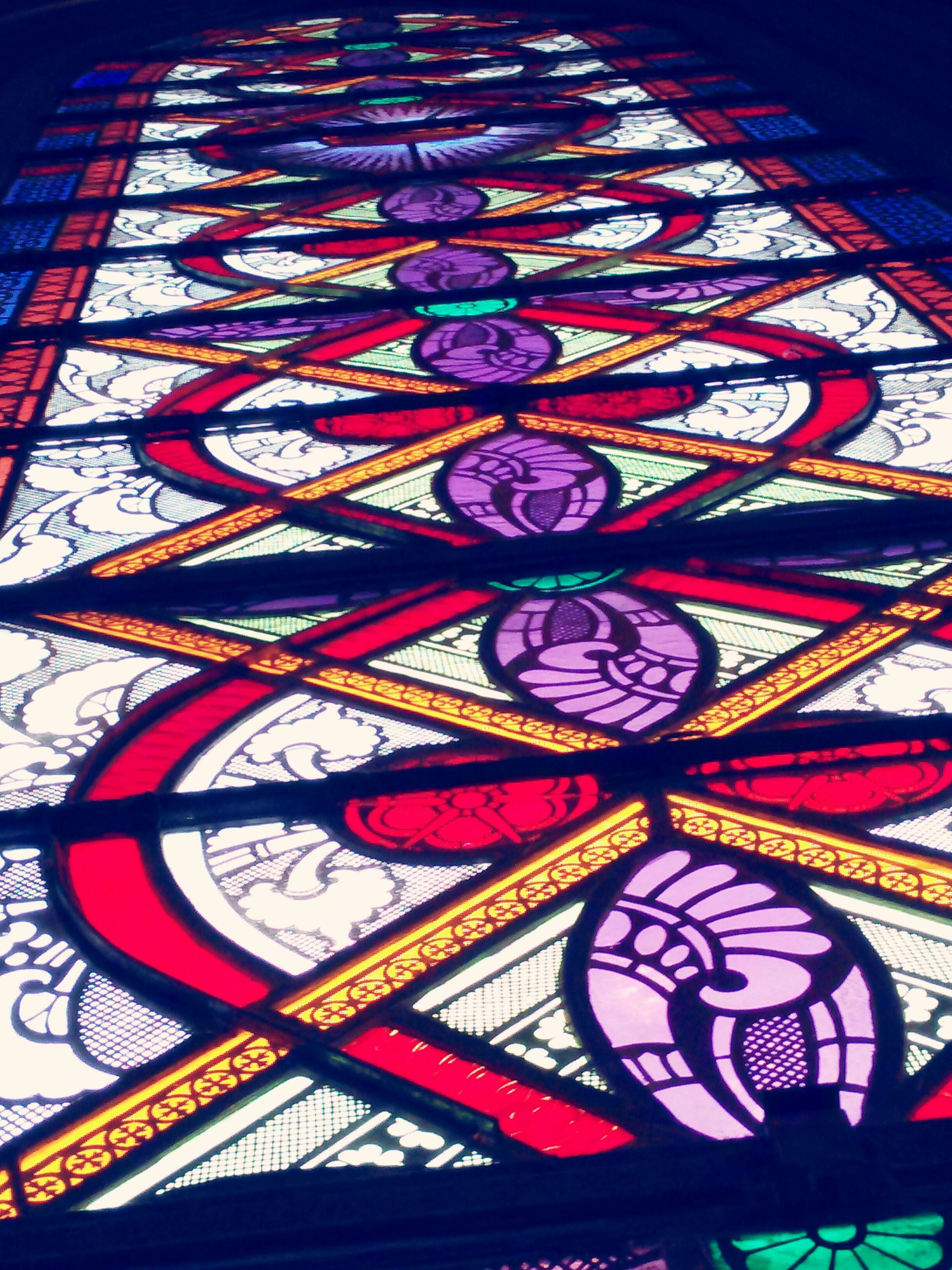 low angle view, pattern, design, indoors, ceiling, architecture, ornate, full frame, art and craft, built structure, multi colored, architectural feature, backgrounds, creativity, art, directly below, decoration, place of worship, religion, illuminated