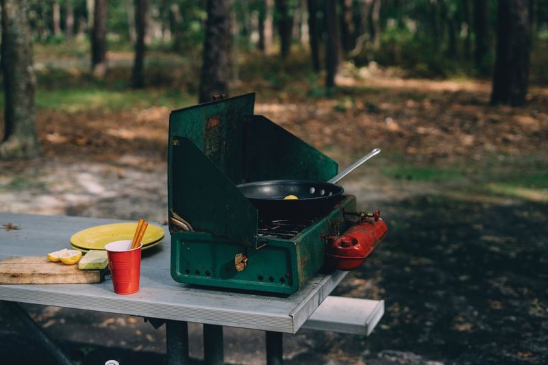 Camping stove Summer Vacations Stove Camping Burning Focus On Foreground No People Container Fire Day Kitchen Utensil Table Food And Drink Outdoors Food Nature