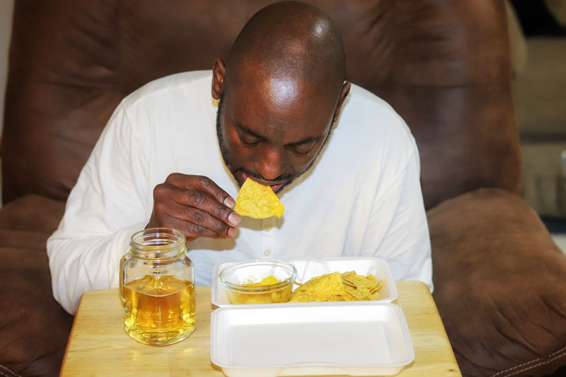 Portrait of man holding  food