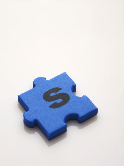 puzzle Alphabet Creativity Teamwork Working Close-up Copy Space High Angle View Ideas Jigsaw Piece Jigsaw Puzzle Last Piece No People Puzzle  Puzzle  Single Object Solution Studio Shot Success Symbol Togetherness Toy White Background