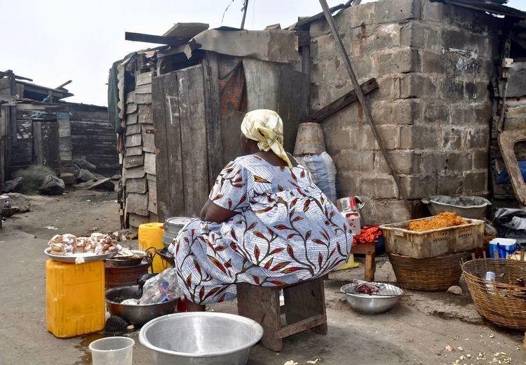 Woman selling food at slum