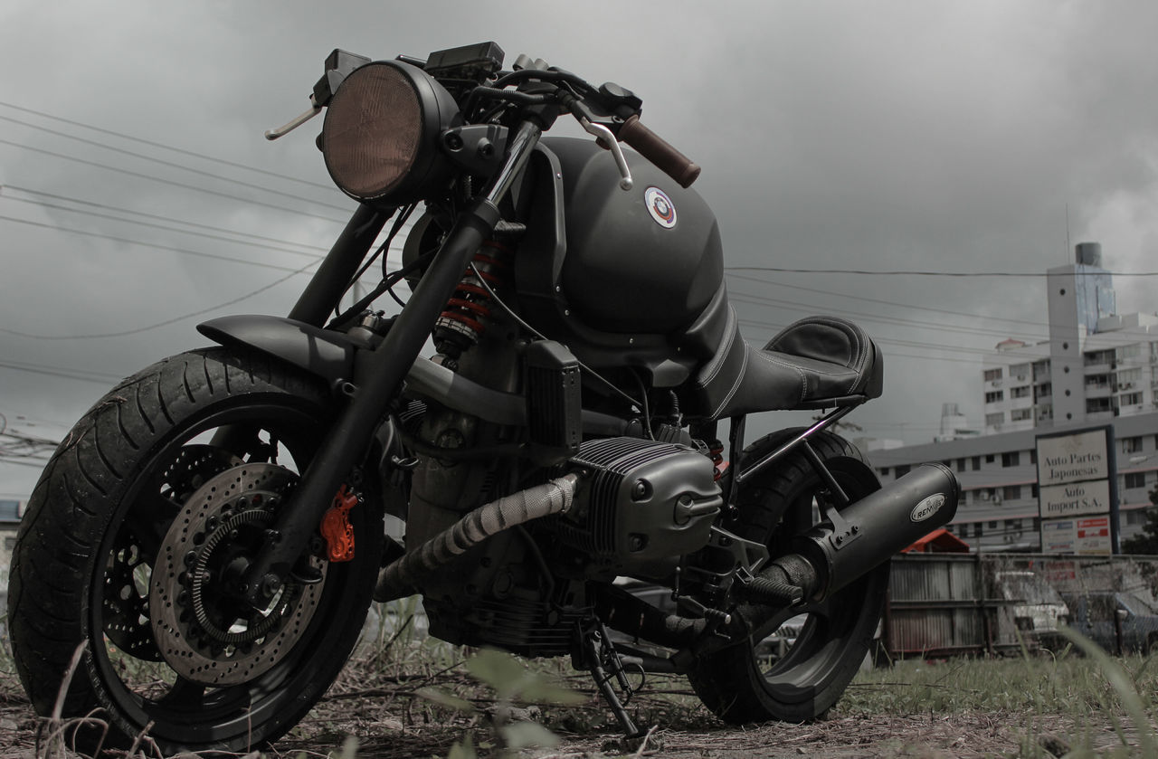 land vehicle, mode of transport, transportation, motorcycle, stationary, no people, outdoors, day, sky