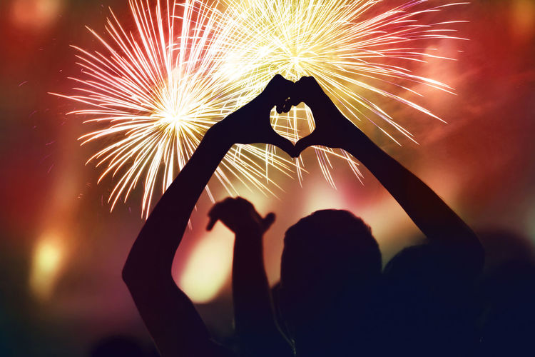 Crowd watching fireworks and celebrating the New Year's Eve. Silhouette of heart shaped hands Explosion Happiness Love New Year's Eve Fireworks New Years Eve 2018 Anniversary Arts Culture And Entertainment Celebration Clock Crowd Firework Firework Display Gatherings Heart Shaped Hand Human Hand Illuminated Leisure Activity Lifestyles New Years Eve Night Party People Real People Silhouette Sparkler