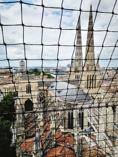 Sightseeing Bordeaux France Culture History Cathedral Cathedral Saint-Andre City Tree Sky Architecture Built Structure Building Exterior Cloud - Sky Chainlink Fence Fence Wire Mesh Security Locked Grid Crisscross Full Frame Backgrounds Boundary