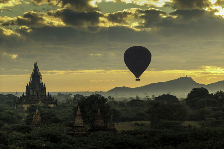 A Hot air Ballon over Bagan Morning Sky Ancient Architecture Bagan Built Structure Burma Clouds And Sky Field History Hot Air Balloon Morning Dust Myanmar No People Religion Spirituality Sunrise Travel Destinations
