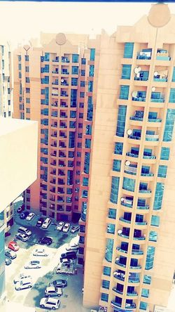 Transportation Architecture Built Structure Building Exterior City Mode Of Transport Land Vehicle Car High Angle View Street Road City Life Day Tall - High Apartment No People Modern Building Story Residential District Dubai Ajman Building Naymiya buildings in Ajman UAE