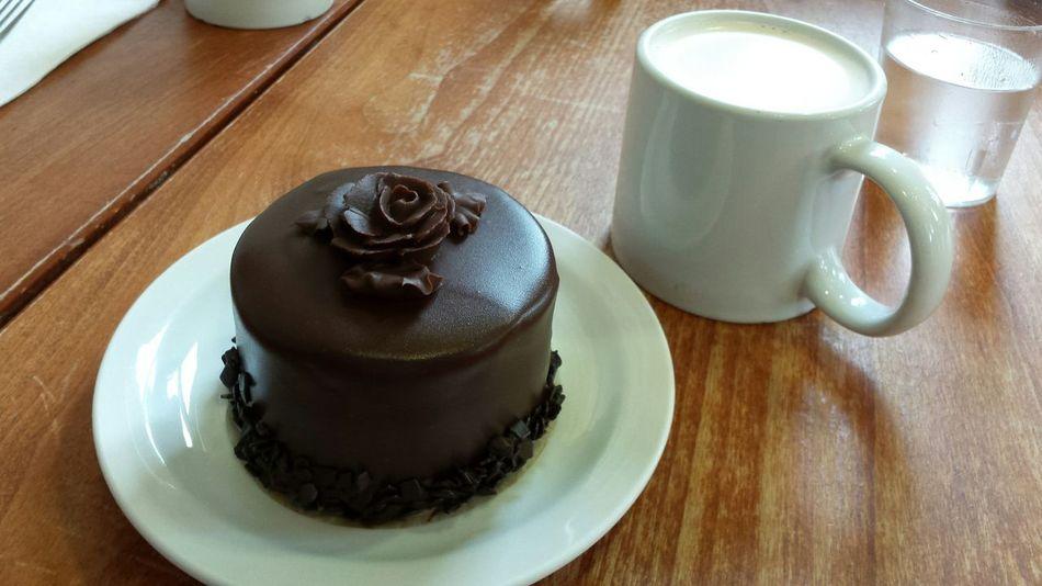 Chocolate Cake On A Table Chocolate Cafe Bakery