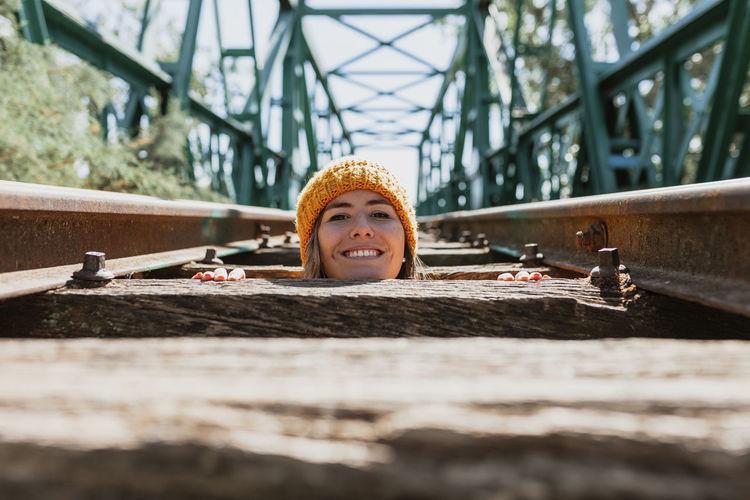 Woman has fun exploring an old, abandoned iron railroad bridge
