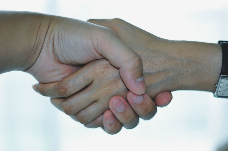 Cropped Image Of Women Shaking Hands