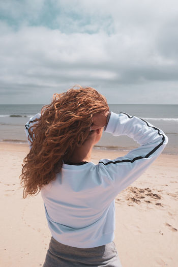 The Week on EyeEm Beach Beautiful Woman Casual Clothing Cloud - Sky Hair Hairstyle Land Leisure Activity Lifestyles Nature One Person Outdoors Real People Sand Sea Sky Standing Water Wind Women