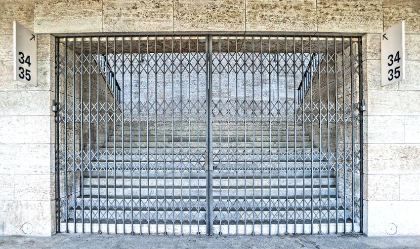 Empty steps seen through closed gate
