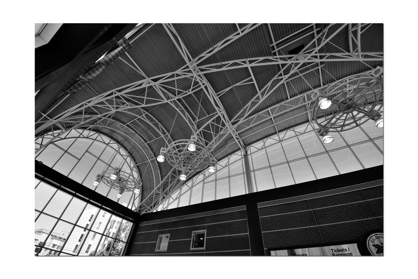 Train Terminal 2 C.L. Dellums Amtrak Station Okj Est.. 1995 Jack London Square Port Of Oakland,Ca. Train Terminal Lines: Capitol Corridor, Coast Starlight, San Joaquin Platform & Track Union Pacific Railroad Architecture Modern Architectural Feature Glass,Steel, Stone Arches Windows Doorways Monochrome_Photography Monochrome Black & White Black & White Photography Black And White Black And White Collection  Light Fixtures Brick Wall Interior Railroad Station Skylight Archway The Architect - 2018 EyeEm Awards