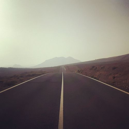 On The Road Road Asphalt The Way Forward Outdoors Landscape No People Ontheroad Fuertaventura Fuerteventura Happiness Nature Photography Nature_collection Loneliness Naturephotography Offroad Feel The Journey The Normal Day Offroaddrive Offroader Offroad Adventure Beauty In Nature Scenics Nature Mountain