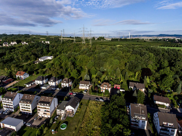 Aerial view of surroundings and village of Andernach in Germany on a sunny summer day with blue sky Tree Plant Architecture Building Exterior Built Structure High Angle View Nature Green Color No People Day Cloud - Sky Building Sky Outdoors House Residential District Environment City Growth Landscape Kettig Andernach Aerial View Drone