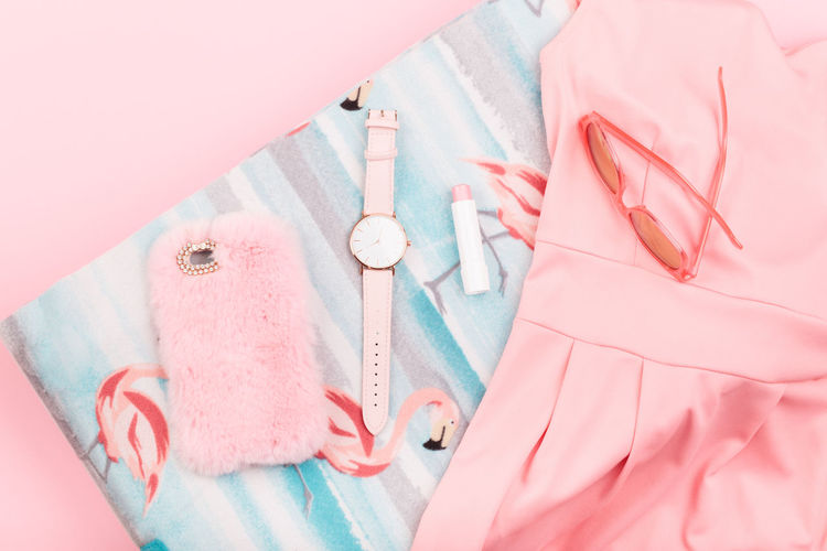 Female pink dress, mobile phone in pink case, watch with pink stripe on pink background Clothes Summer Summertime Casual Clothing Fashion Girlish Lifestyle Original Style Top View Watch Female Pink Color Bright Dress Case Mobile Phone Stylish Lipstick