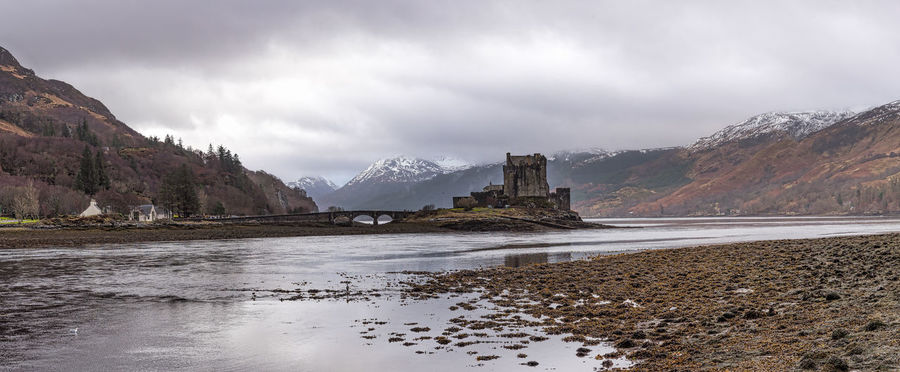 Eileasn Donan Castle Kyle Of Loch Alsh Bridge - Man Made Structure Cloudy Sky 💙 Day Mountains No People Old Castle Ruin Photo Merge Photography Water Mountain Sky Nature Beauty In Nature Scenery Landscape Outdoors