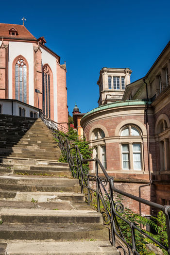 Old stairs and church in Baden-Baden, Germany Baden-Baden Germany Old Stairs Architecture Built Structure Staircase Building Exterior Building Sky Blue Nature Sunlight Place Of Worship Steps And Staircases Religion Railing Clear Sky Direction City Belief No People Outdoors Location
